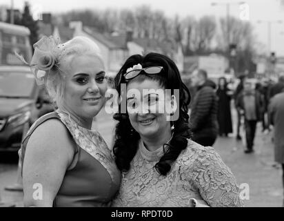 The girls are all dressed up in their finest for a day out at The Randox Health Grand National, Aintree, Liverpool UK 2018 - Stock Photo