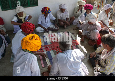 Chopat is an ancient Ludo like game that is played in a bantering manner. Commonly enjoyed by social groups of old men in Rajasthan villages - Stock Photo