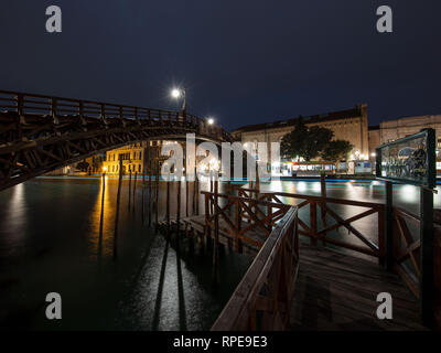 A beautiful shot of a Gondola Station in Venice, Italy. Looking over towards the Academia Bridge late one evening. - Stock Photo