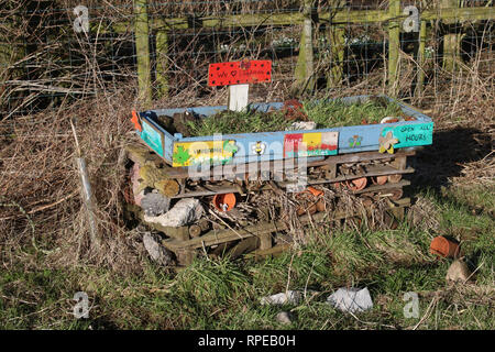 Insect house made from a recycled pallet and placed for the use of wildlife on a community field in Pilling, Lancashire, England seen in winter. - Stock Photo