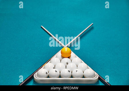 Russian billiard balls, cue, triangle, on a table. blue cloth with space for text - Stock Photo