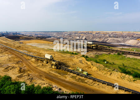GARZWEILER, GERMANY - 28 May 2017: A large bucket wheel excavator in a lignite (brown-coal) mine during sunset, Germany energy - Stock Photo