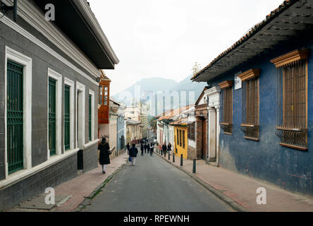 Colourful street views with locals and Spanish colonial houses in La Candelaria, the historical district of Bogota, Colombia. Sep 2018 - Stock Photo