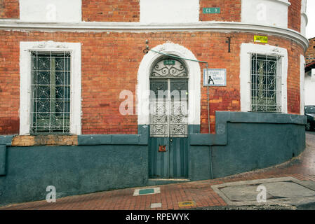 Stylish colonial exterior with decorated door and windows in La Candelaria, the historical district of Bogota, Colombia. Sep 2018 - Stock Photo