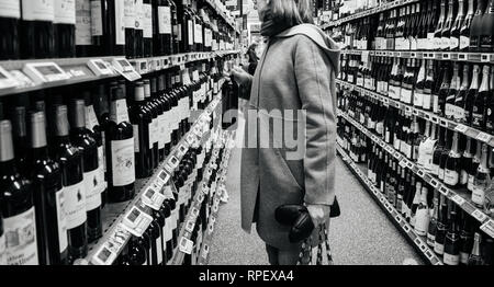 strasbourg-france-dec-30-2017-elegant-french-woman-buying-diverse-alcoholic-drinks-wines-champagne-and-whiskey-in-wine-department-of-a-large-french-supermarket-black-and-white-image-rpexa4 What Every New bride Wants -- Ideas By Female Brides to be