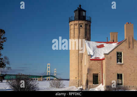 Mackinaw City, Michigan - The Old Mackinac Point Lighthouse at the Straits of Mackinac. The lighthouse operated from 1890 until the Mackinac Bridge op - Stock Photo