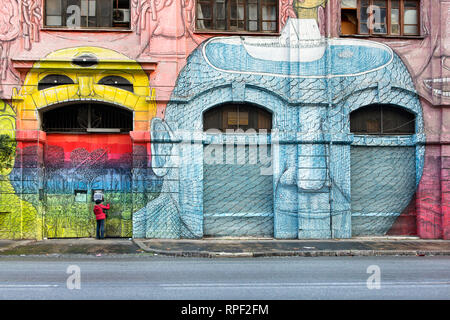 ROME - A squated former military barrack in Ostiense is covered with gigantic alien faces by Italian artist BLU. - Stock Photo