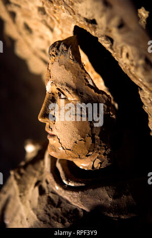 NAPLES - Statue of a saint at the Fontanelle cemetery. - Stock Photo