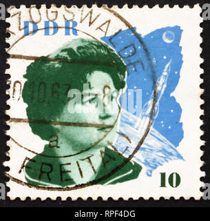 GDR - CIRCA 1963: a stamp printed in GDR shows Valentina Tereshkova and Space Craft, the First Woman in Space, circa 1963 - Stock Photo