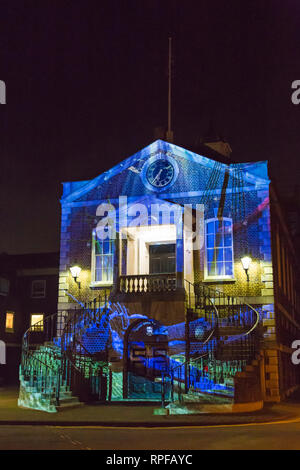 Poole, Dorset, UK. 21st Feb, 2019. Light Up Poole. Visitors head to Poole to experience the digital light art festival that takes place in various locations around Poole, to illuminate, de-light and transform the town. The 3 night festival showcases the work of emerging and international artists with a series of light art, digital installations and participation. Ebbs and Flows by Ashley Wilkie a journey across the ocean is projected onto the Guildhall. Credit: Carolyn Jenkins/Alamy Live News - Stock Photo
