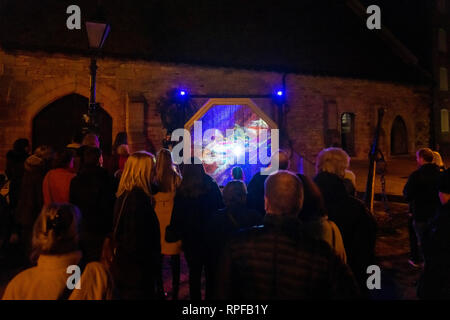 Poole, UK. 21st Feb, 2019. Poole, Dorset. 21st February 2019. Hundreds of visitors head to Poole Quay and town centre to see the light and art installations as part of the 'Light Up Poole' arts festival. Lottery and Arts Council England funded, the free night time event carries on until the 23rd February in Poole. Credit: Thomas Faull/Alamy Live News - Stock Photo
