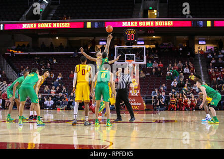 LOS ANGELES, CA - FEBRUARY 21: USC Trojans forward Nick Rakocevic (31) and Oregon Ducks forward Kenny Wooten (14) tip off at the beginning of a college basketball game between the Oregon Ducks and the USC Trojans on February 21, 2019 at Galen Center in Los Angeles, CA. (Photo by Jordon Kelly/CSM) - Stock Photo