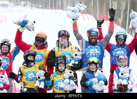 Russia. 22nd Feb, 2019. CHELYABINSK REGION, RUSSIA - FEBRUARY 22, 2019: Participants in a FIS SnowKidz relay race as part of the 2018/19 FIS Freestyle Skiing World Cup at the Solnechnaya Dolina [Sun Valley] alpine skiing complex in the city of Miass. Donat Sorokin/TASS Credit: ITAR-TASS News Agency/Alamy Live News - Stock Photo