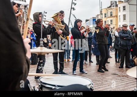 Cork, Ireland. 22nd Feb, 2019. Cork based brass band 'Rebel Brass' played in Cork city centre in front of huge crowds today. The band, made up of 12 to 18 year old young people, played on the Late Late Toy Show in November. Credit: Andy Gibson/Alamy Live News. - Stock Photo