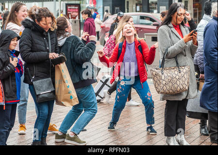 Cork, Ireland. 22nd Feb, 2019. Cork based brass band 'Rebel Brass' played in Cork city centre in front of huge crowds today. These two girls danced their socks off! The band, made up of 12 to 18 year old young people, played on the Late Late Toy Show in November. Credit: Andy Gibson/Alamy Live News - Stock Photo
