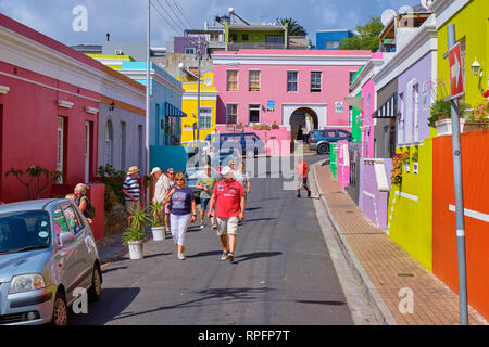 Tourist walking on main street of colourful facades of the houses in Bo Kaap, Cape town. - Stock Photo