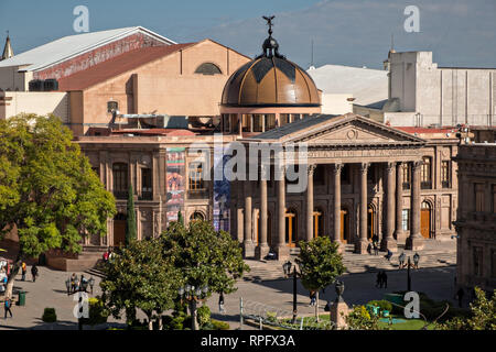 Elevated view of the Teatro de la Paz or Theater of Peace in the historic center on the Plaza del Carmen in the state capital of San Luis Potosi, Mexico. The building was built by the architect Jose Noriega with French influences and neoclassical style, with its facade in pink quarry in 1894. - Stock Photo