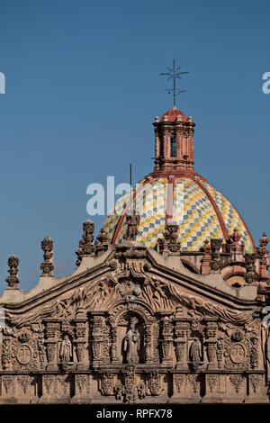 The tiled dome on the Baroque Churrigueresque style Iglesia del Carmen church and convent in the historic center on the Plaza del Carmen in the state capital of San Luis Potosi, Mexico. - Stock Photo