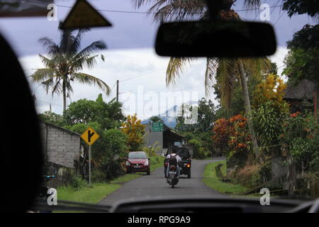 A taxi drive in Bali, Indonesia. - Stock Photo