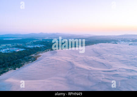 Beautiful white sand dunes and surrounding hills at sunrise. Anna Bay, New South Wales, Australia - Stock Photo
