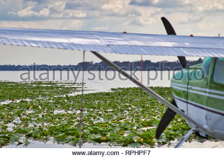 Airplane with floats waiting to take off on a lake in Florida - Stock Photo