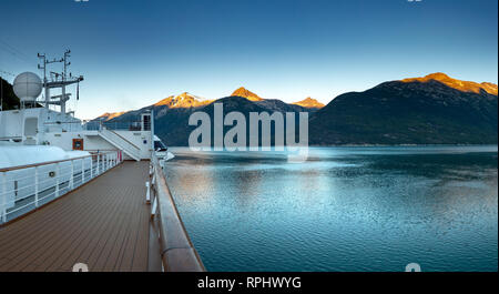 September 15, 2018 - Skagway, AK: Sunrise alpenglow light on mountains and view of Taiya Inlet from The Volendam cruise ship Sports Deck while arrivin - Stock Photo