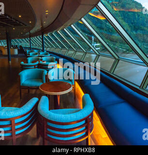 September 15, 2018 - Skagway, AK:  Empty seats at dawn, early morning inside The Crow's Nest lounge aboard The Volendam cruise ship while docked in po - Stock Photo