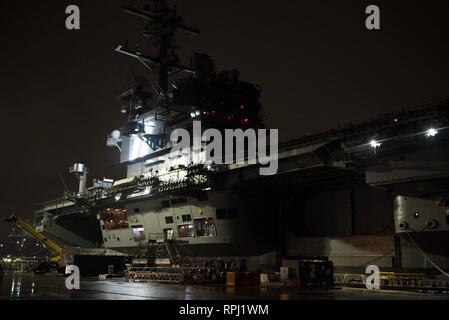 190221-N-KO018-0011 NORFOLK, Va. (Feb. 21, 2019) The aircraft carrier USS George H.W. Bush (CVN 77) is moored at Pier 12 onboard Naval Station Norfolk. GHWB is at Norfolk Naval Shipyard undergoing a Docking Planned Incremental Availability (DPIA). (U.S. Navy photo by Mass Communication Specialist Seaman Carson J. Davis) - Stock Photo