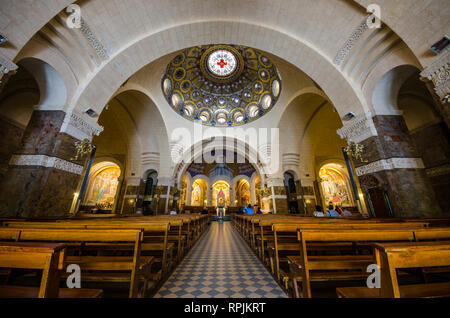 FRANCE LOURDES SEP 2018 view of interiors of basilica in Lourdes town. The town is a place where st Mary appeared before a peasant girl - Stock Photo