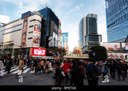 TOKYO, JAPAN - NOV 25:  Slow exposure of pedestrians, cars and buses at Shibuya Crossing on November 25, 2018. The crossing is regarded as the world's - Stock Photo