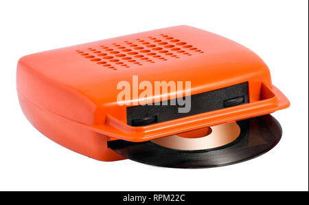 Old red plastic vintage record player for vinyl records isolated on white with a records in position - Stock Photo
