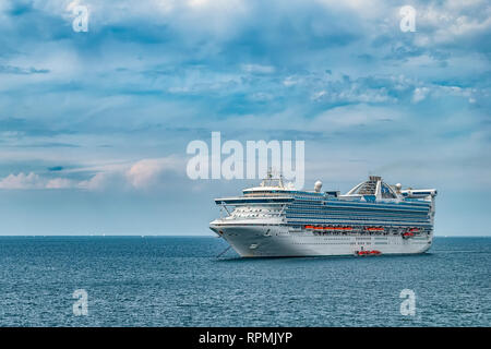 HELSINGBORG, SWEDEN - JULY 15, 2009: The luxury cruise ship Grand Prinsess sits anchored off shore at Helsingborg in Sweden. - Stock Photo