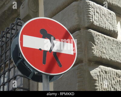 funny drive in prohibited warning sign, hard to carry man heavy weight - Stock Photo