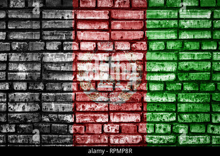 National flag of Afghanistan on a brick background  Concept image