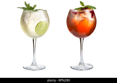 Two cocktails with mint, fruit and berries on a white background. Cocktails in glass goblets. Isolated. - Stock Photo