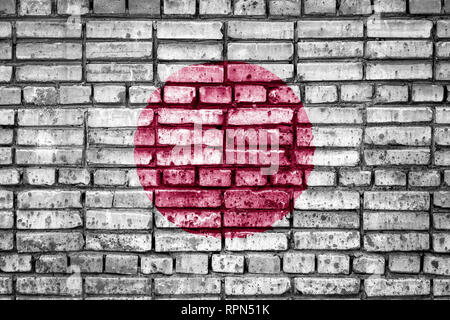 National flag of Japan on a brick background. Concept image for Japan: language , people and culture. - Stock Photo