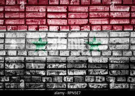 National flag of Syria on a brick background. Concept image for  Syria: language , people and culture. - Stock Photo