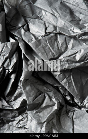 background made of a closeup of a crumpled gray paper - Stock Photo