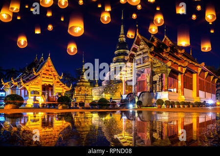 Yee peng festival and sky lanterns at Wat Phra Singh temple at night in Chiang mai, Thailand. - Stock Photo