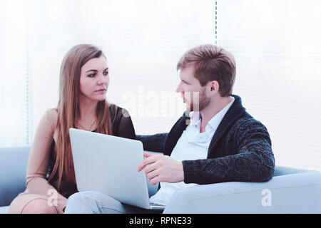two employees sitting near the window in the office.photo with copy space - Stock Photo