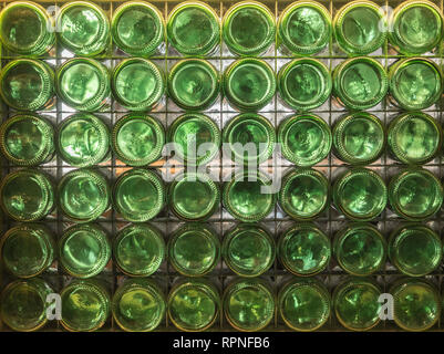 Composition made of green bottles seen from the bottom of the bottle. background - Stock Photo
