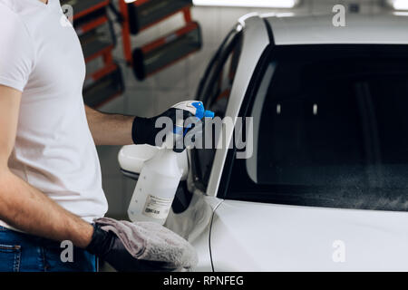 guy washing the windshield in the car wash station, close up cropped photo. copy space - Stock Photo
