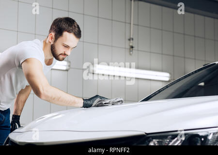 guy finishing to wash his vehicle, close up photo. copy space.car dry cleaning process - Stock Photo