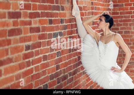 girl is concentrated on split, close up side view photo. copy space - Stock Photo
