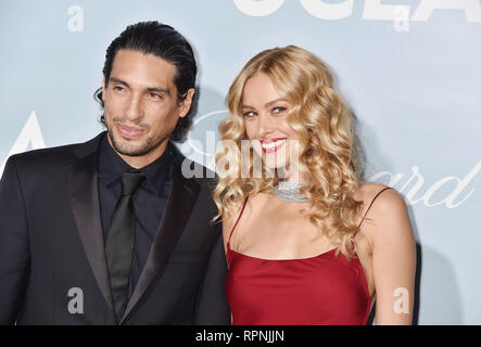 LOS ANGELES, CA - FEBRUARY 21: Benjamin Larretche (L) and Petra Nemcova arrive at the Hollywood For Science Gala at Private Residence on February 21,  - Stock Photo