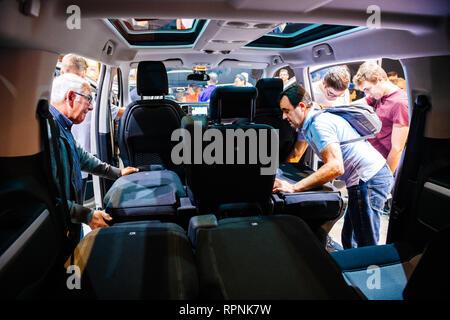 PARIS, FRANCE - OCT 4, 2018: Professionals admiring the interior and seat configuration of new Citroen Berlingo utility van at International car exhibition Mondial Paris Motor Show - Stock Photo