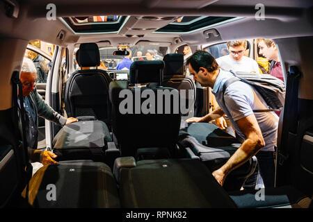 PARIS, FRANCE - OCT 4, 2018: Customers curious people admiring the interior and seat configuration of new Citroen Berlingo utility van at International car exhibition Mondial Paris Motor Show - Stock Photo
