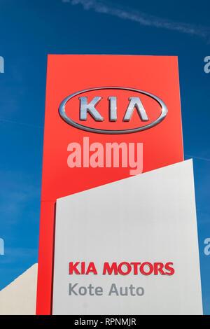 RONCQ,FRANCE-February 20,2019: KIA brand logo on a blue sky background. - Stock Photo