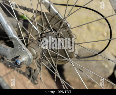 Old bicycle chain and spokes in closeup - Stock Photo