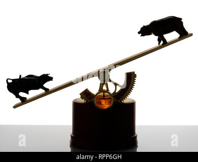 The Market, executive toy (!) that displays the balance of the stockmarket. Bull and bear at opposing ends of a see-saw. - Stock Photo